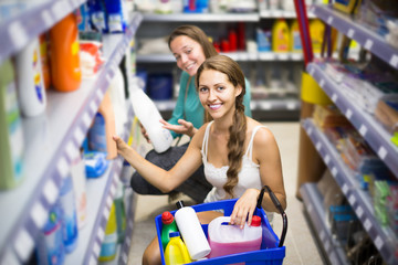 people choose some detergents in the shop