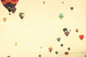 Vintage textured hot air balloons in flight