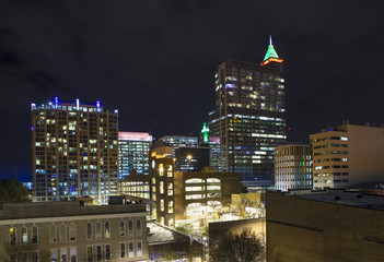 low aerial view of Raleigh at night