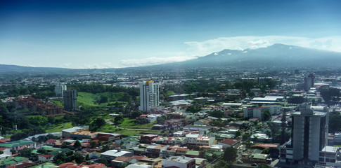 Aerial view of cityscape with mountain range in background, Costa Rica