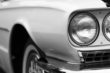 Fotobehang Vintage cars Close-up of left headlights of a white shiny classic vintage car