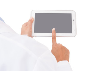 Doctor working on a digital tablet on white background.
