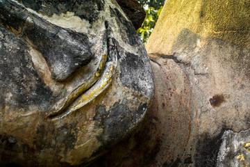 Smiling Stone Buddha Statue on the face, Kamphaeng Phet Thailand.