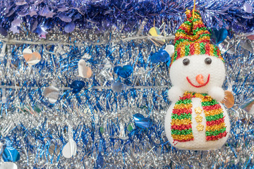 Snowman and tinsel  holiday background