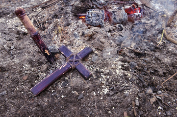 Wooden cross and stake in fire horizontal