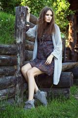 Outdoor fashion portrait of young beautiful woman. Boho chic sty