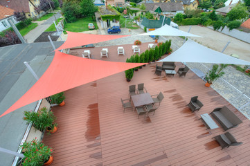Terrace in summer with shade sails