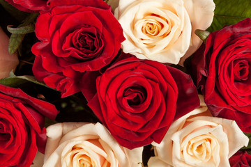 Big red and yellow roses bouquet background, top view