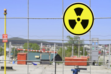 The radioactivity sign on the fence of the facility
