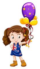 Little girl holding fancy balloons