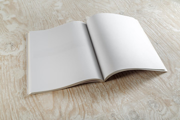 Blank booklet magazine on wooden background. Mockup for graphic designers portfolios.