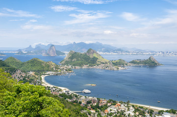 City skyline scenic overlook of Rio de Janeiro, Brazil with Niteroi, Guanabara Bay, and Sugarloaf Mountain