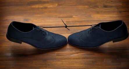 Man's shoes on dark wooden background