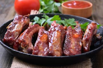 Grilled pork ribs in frying pan