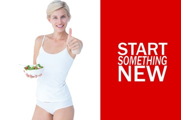 Fit woman holding a bowl of salad