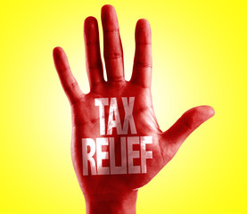 Tax Relief written on hand with yellow background