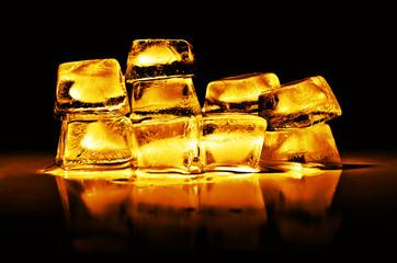 Gold bullion on a black background