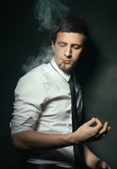 Elegant young man smoking