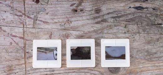 Slides on wooden background