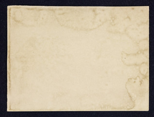 Old grunge paper sheet, isolated on black background.