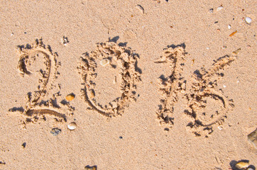 New Years 2016 concept; 2016 on the sand backgroung Texture