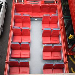 Empty red seats on a bus