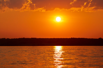 Wall Mural - Sunset or sunrise over a river or lake