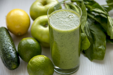 Green Smoothie Close up. Over White Wooden Background.