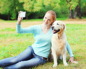 Happy owner woman with Golden Retriever dog taking selfie portra