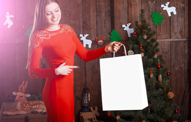 Beautiful happy woman with present