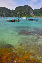 Paradise tropical stone sea bay with boats