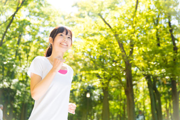 young asian woman jogging image