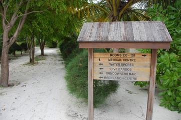 Timber direction signs at Bandos Island Maldives