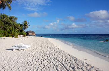 White sand beach with deckchairs