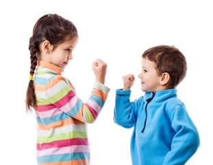 Two children threaten each other a fist