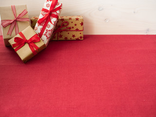 Christmas presents on red tablecloth