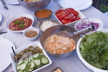 Party table full of salads