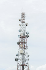 transmitters and aerials on the telecommunication tower whit cloudy