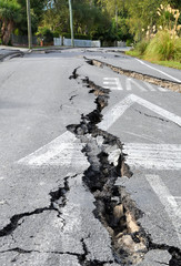 Enormous cracks in a road caused by a devastating earthquake in Christchurch, New Zealand.