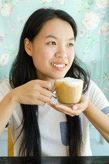 Young asian woman drinking coffee in the morning