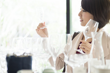 Women are choosing a champagne glass in a tableware store