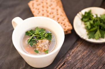 Soup with meatballs and parsley