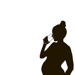 silhouette of a pregnant woman with a glass of water