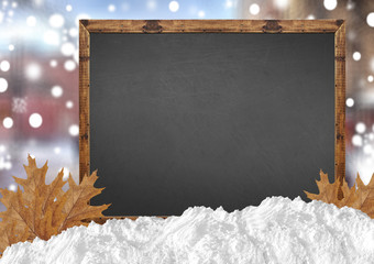 Blank blackboard with blurr city and snow and leaves
