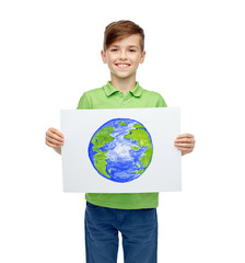 happy boy holding drawing or picture of earth