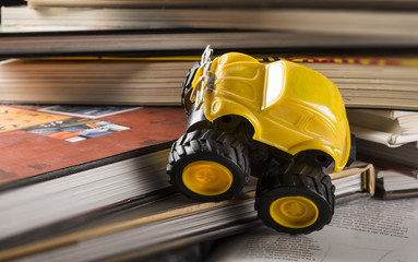 cars climbing on a pile of books