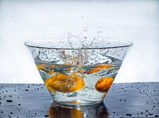 Orange splashes water