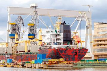 Obraz Gdynia. Cargo ship at the dock. - fototapety do salonu