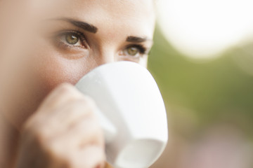 Close view of woman drinking coffee