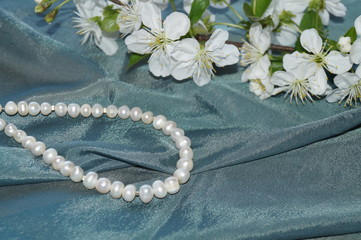 Pearls, spring flowers (cherry blossoms) and silk